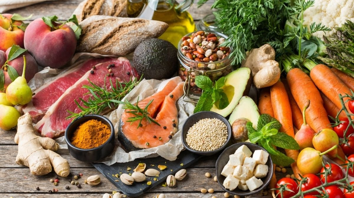 A spread of omega-3 based foods including salmon, avocado, nuts and oils.