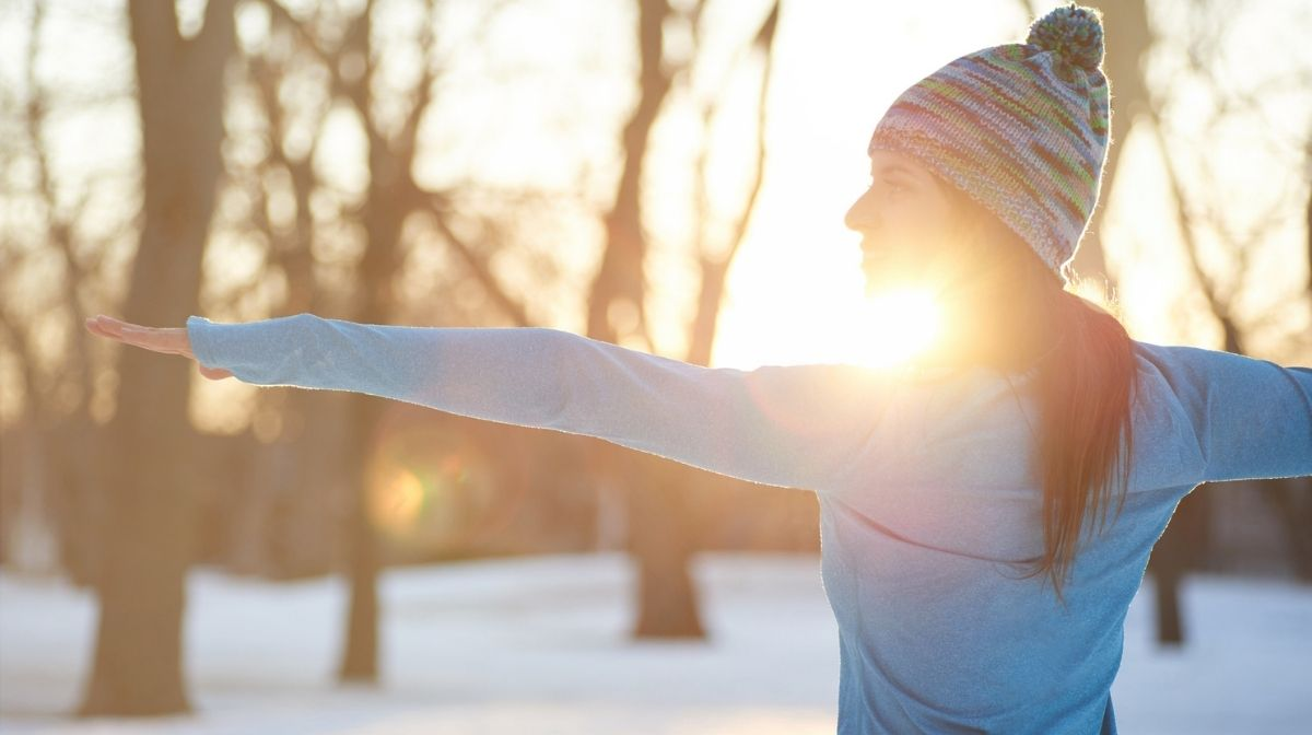 woman doing yoga outdoors in winter