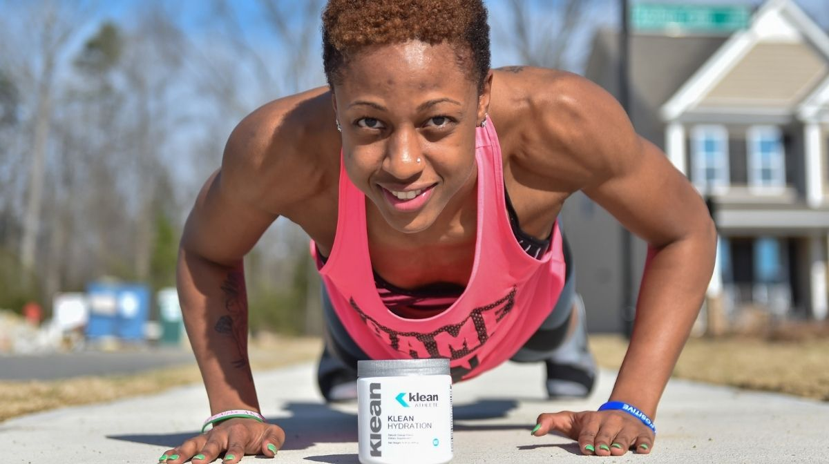 athlete using Klean Athlete products while working out
