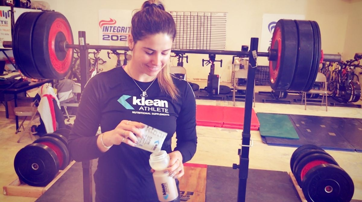 athlete making a protein shake using Klean Isolate