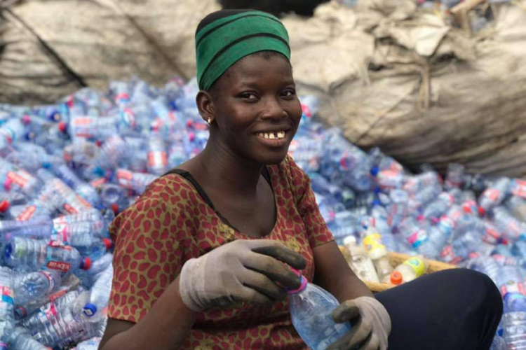 A waste worker in Ghana, collecting plastic waste