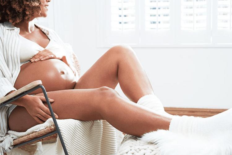 Pregnant woman cradling bump