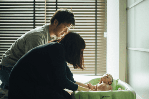 parents with baby bath time