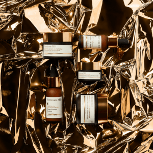 PMD products on gold, festive backdrop