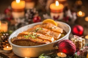Festive salmon on tray with candles
