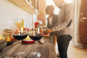 Romantic black couple preparing healthy meal together
