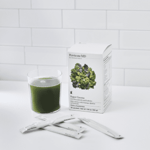Supergreen supplements in a cup on the kitchen counter