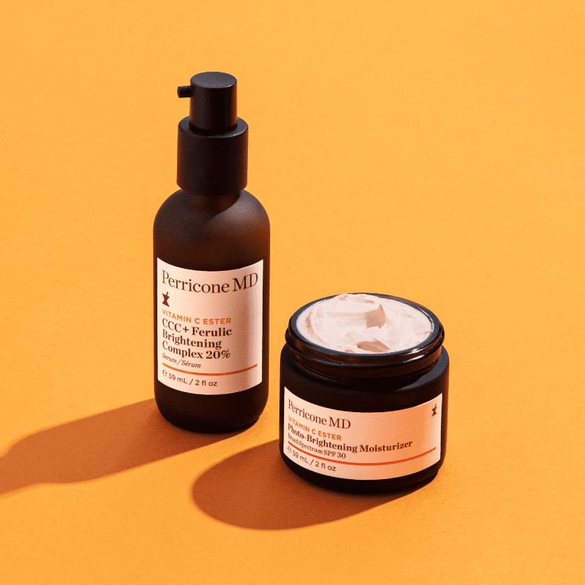 brightening duo creams on a orange background