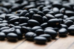 Black Raw Beans on a wooden table
