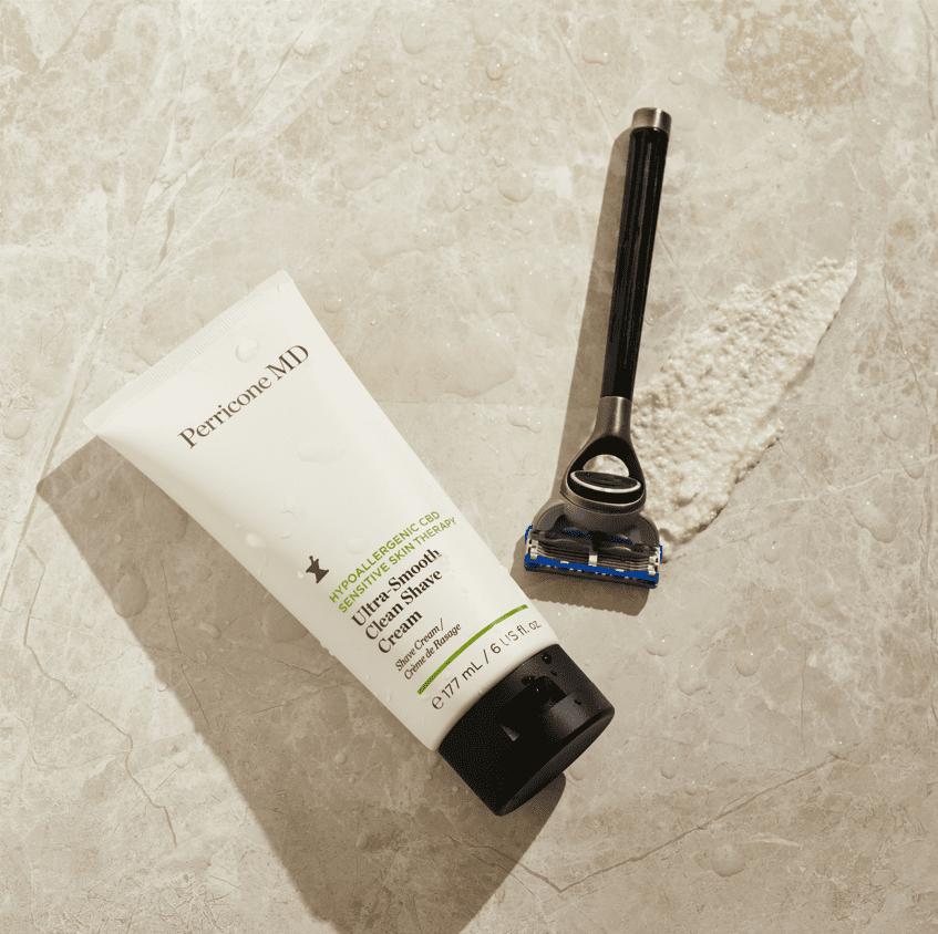 Shaving Cream with Razor Blade on a Textured Background