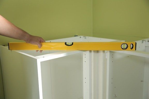 Check both cabinets with a spirit level