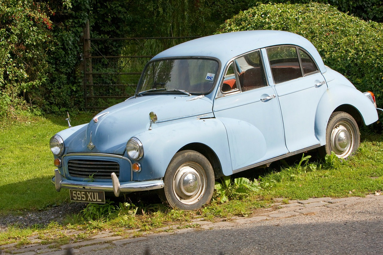 baby blue morris minor parked on grass