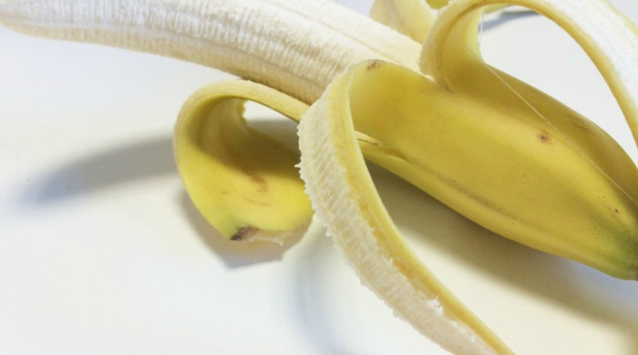 A peeled banana, which is used in our banana and coconut smoothie juice diet recipe.