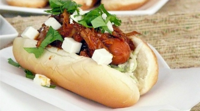A hot dog with pulled pork.