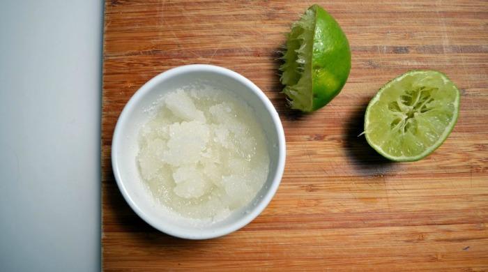 A bowl of coconut oil and sugar scrub exfoliator.