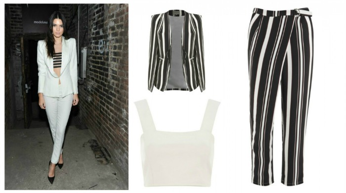 Kendall Jenner wearing a white trouser suit and striped bandeau.