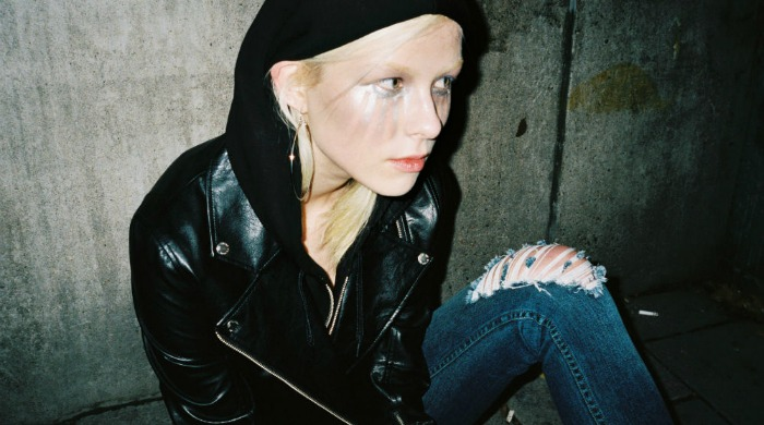 A woman wearing a Cheap Monday leather jacket and jeans.