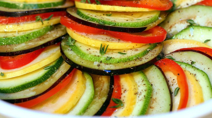 Ratatouille neatly layered ready to be baked.