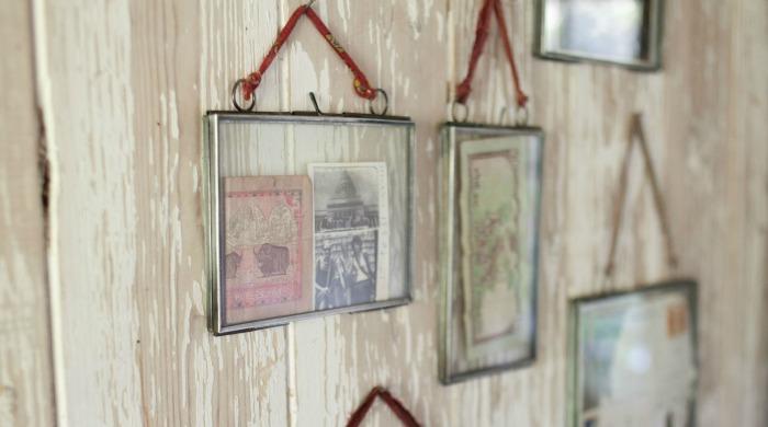 Nkuku Kiko Glass Frames hanging on a wall.