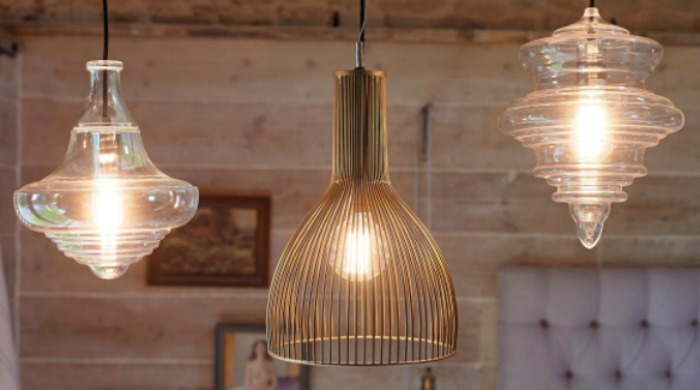 Three Parlane statement light fittings in glass and copper.