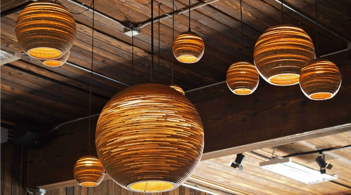 Seven Graypants Moon Pendant Lampshades hanging from a wooden ceiling.
