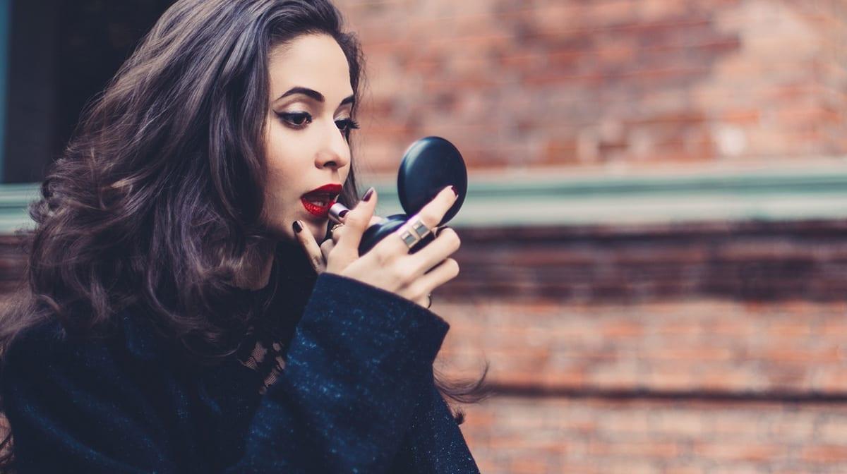 Go dark with your nail polish this festive season (like Meghan Markle)