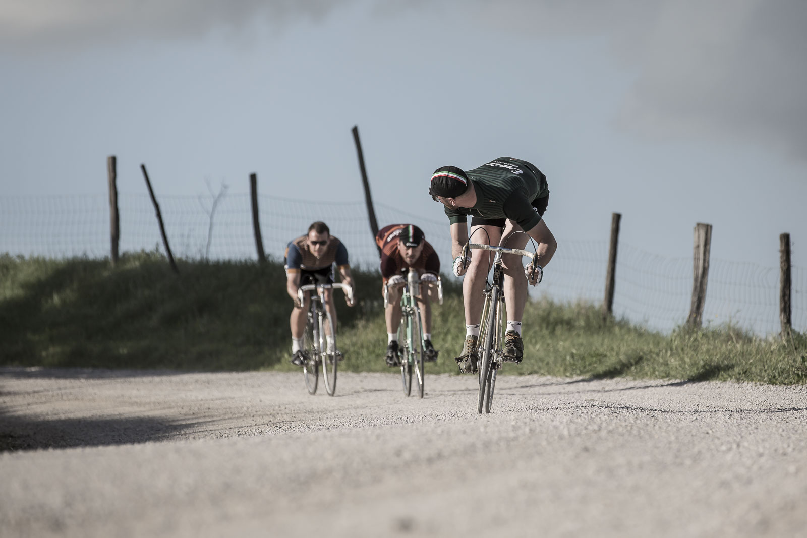 Three cyclists racing in Eroica kit