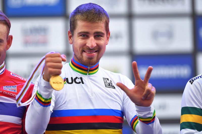 Peter sagan on the podium in norway wearing his world championships jersey after winning the elite mens road race for the third year in a row