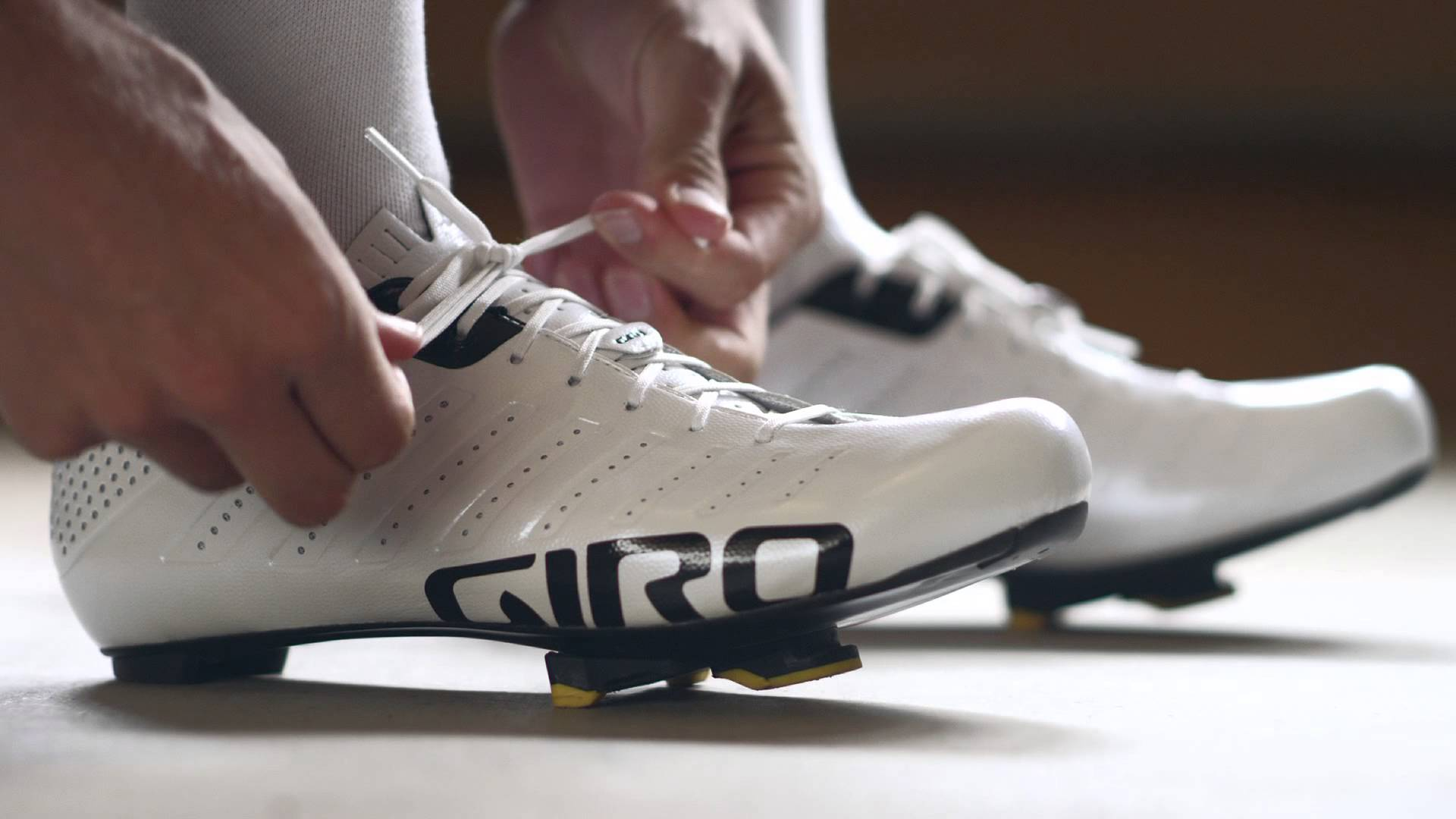Taylor Phinney putting on giro empire slx road cycling shoes