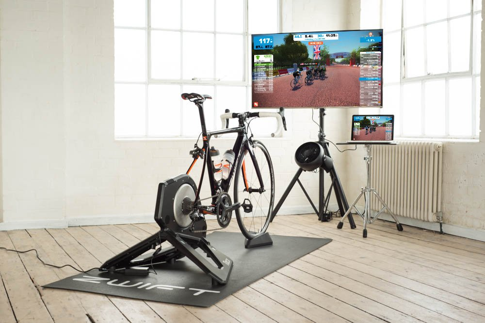A Tacx Neo turbo trainer setup for Zwift, training on the turbo can be a great way to balance cycling and work.