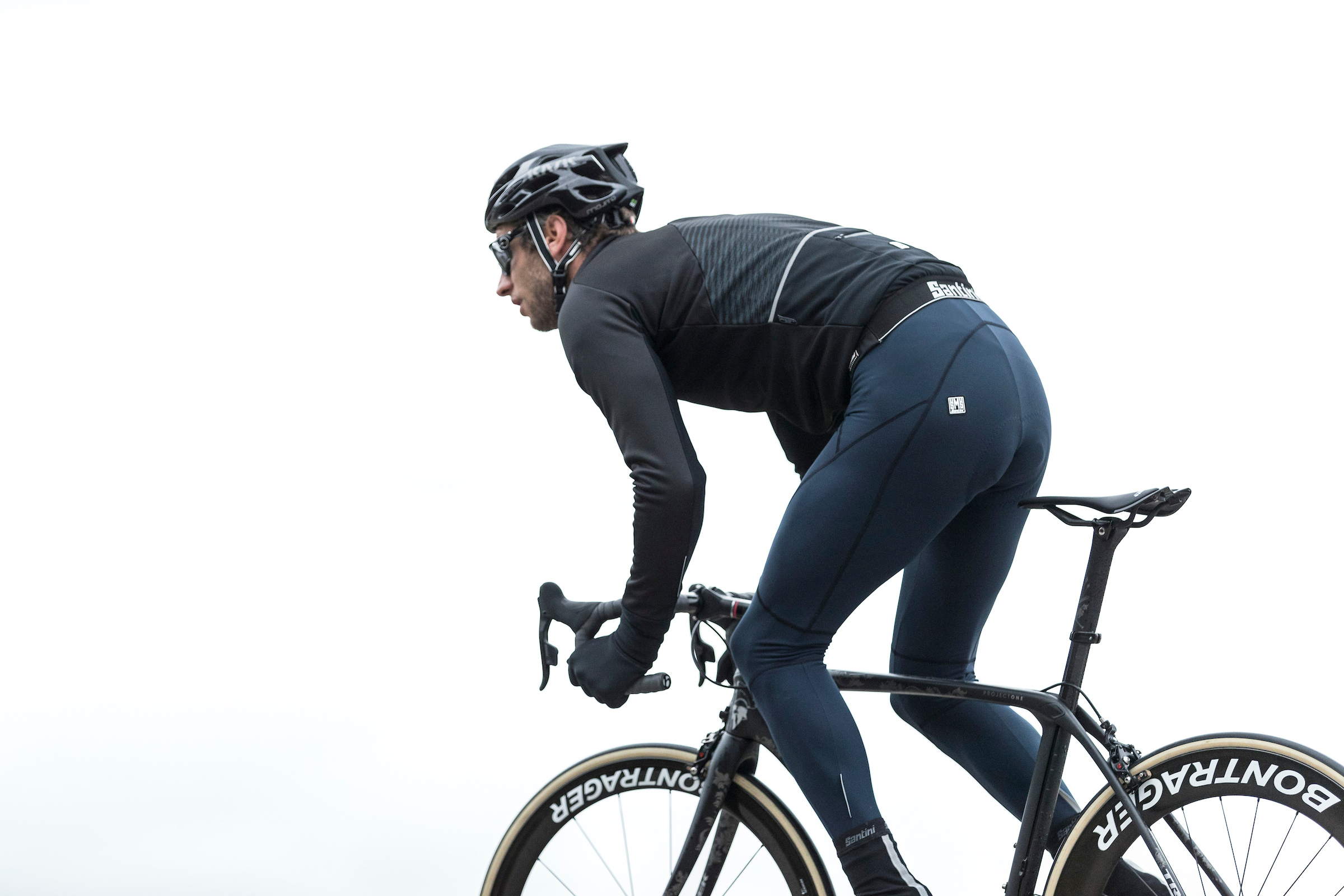 A cyclist and the santini beta jacket and myego bib-tights