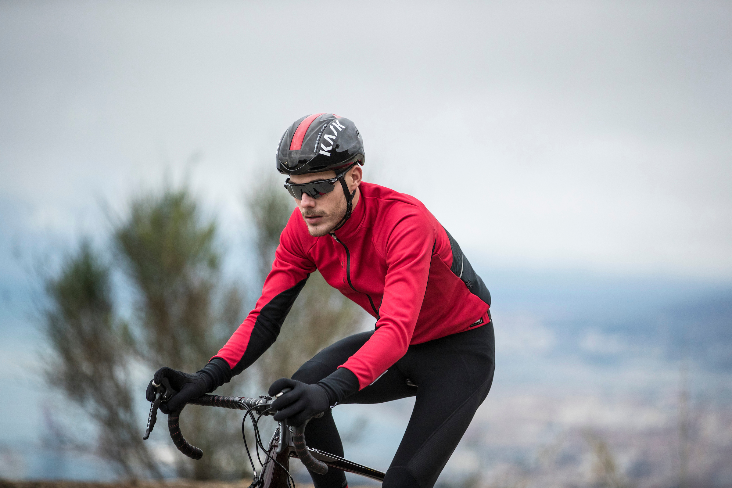 A cyclist wearing the Santini Cycling Beta jacket
