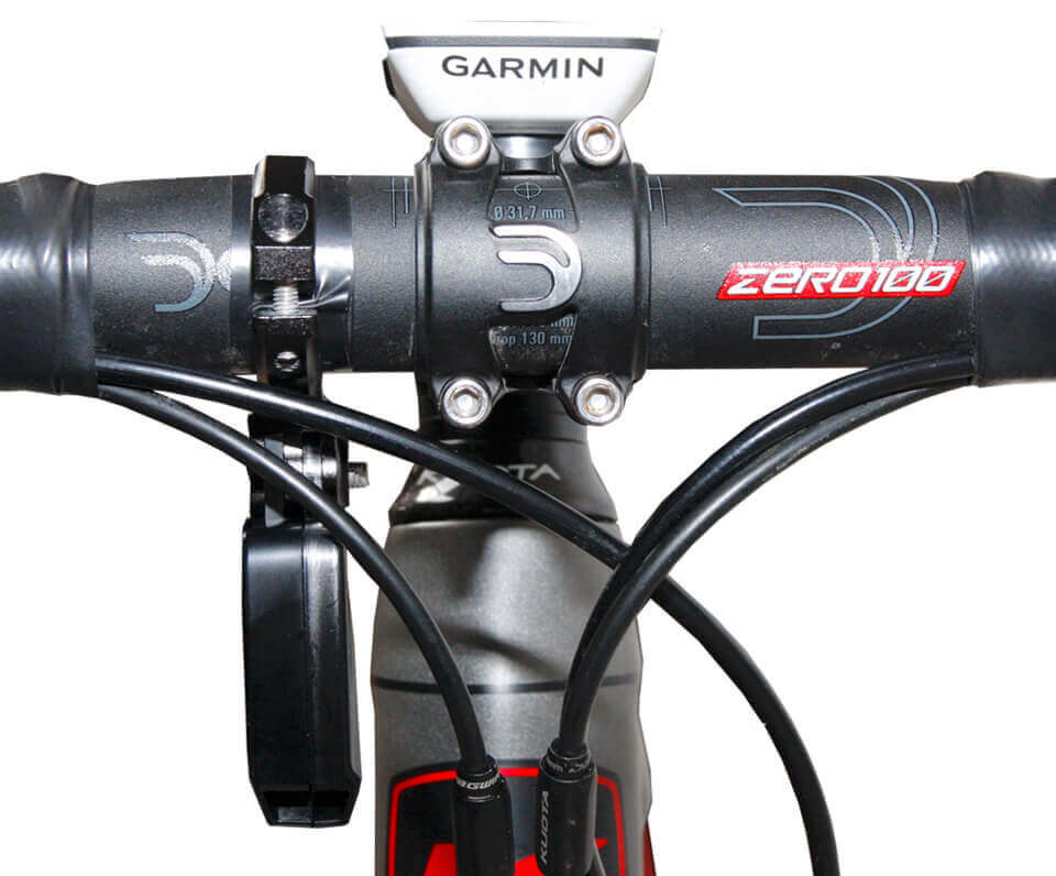 A powerpod power meter attached to the handlebars of a road bike