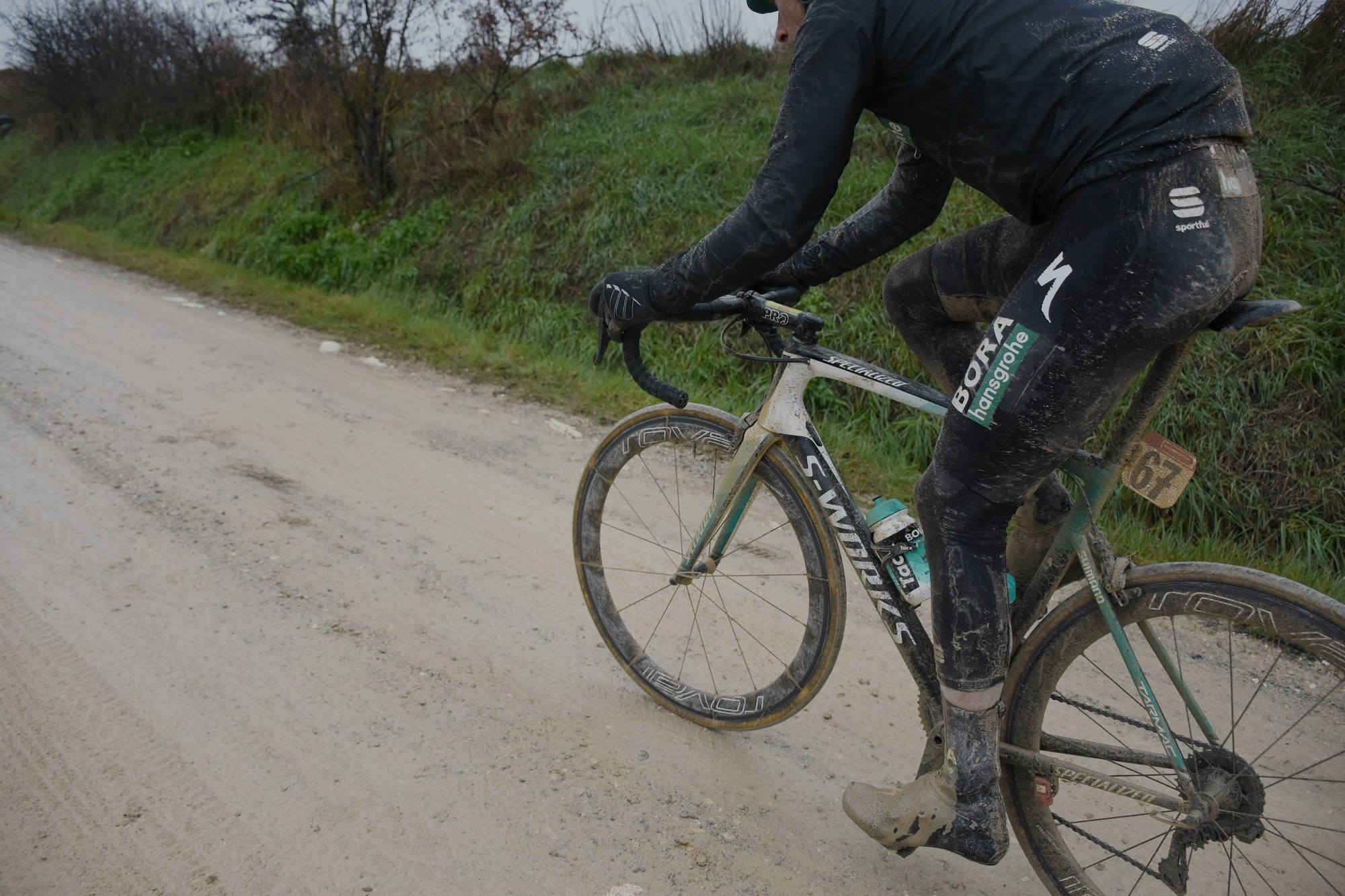 a bora hangrohe rider in sportful kit covered in mud
