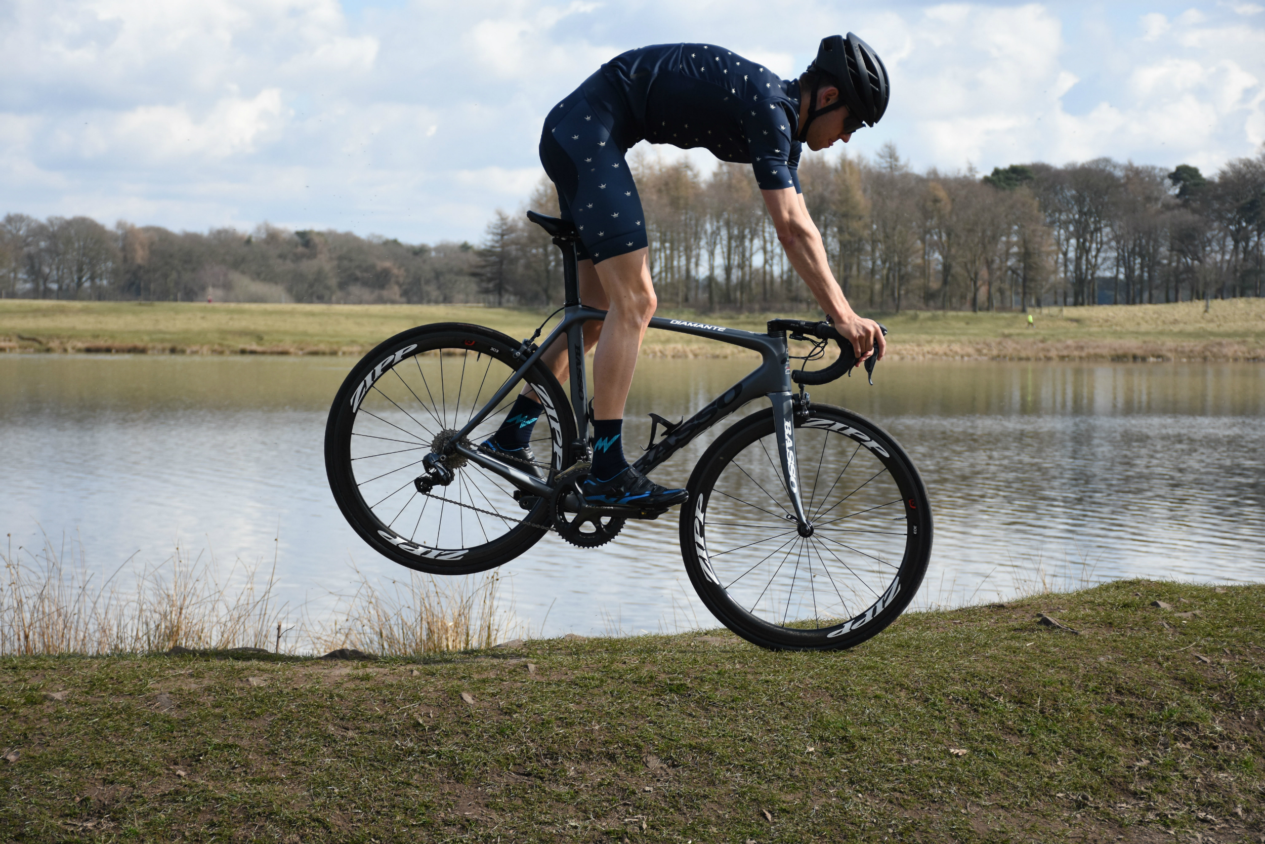 A cyclist doing a nose-stand in the morvelo SS18 KOM range