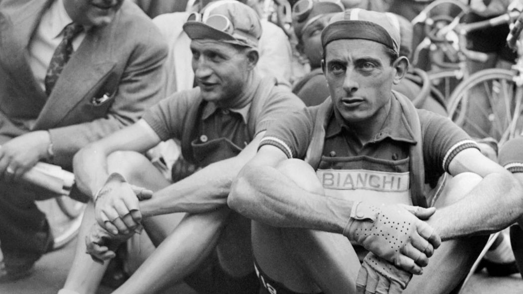 Bartoli and Fausto Coppi sat wearing cycling caps.