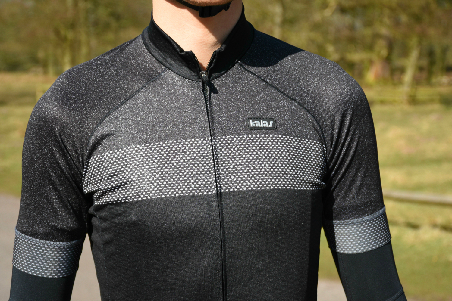 A cyclist in Kalas Passion jersey.