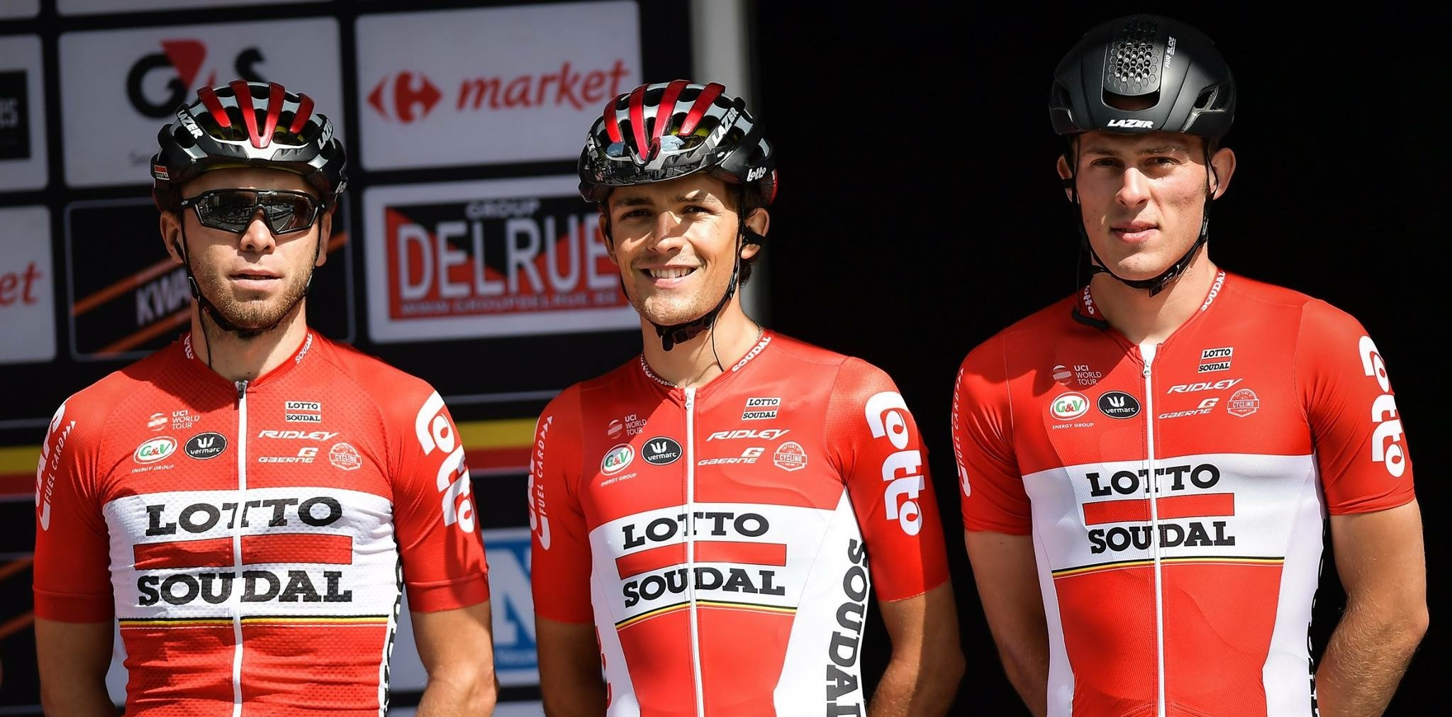 James shaw on the podium with his Lotto-Soudal teammates