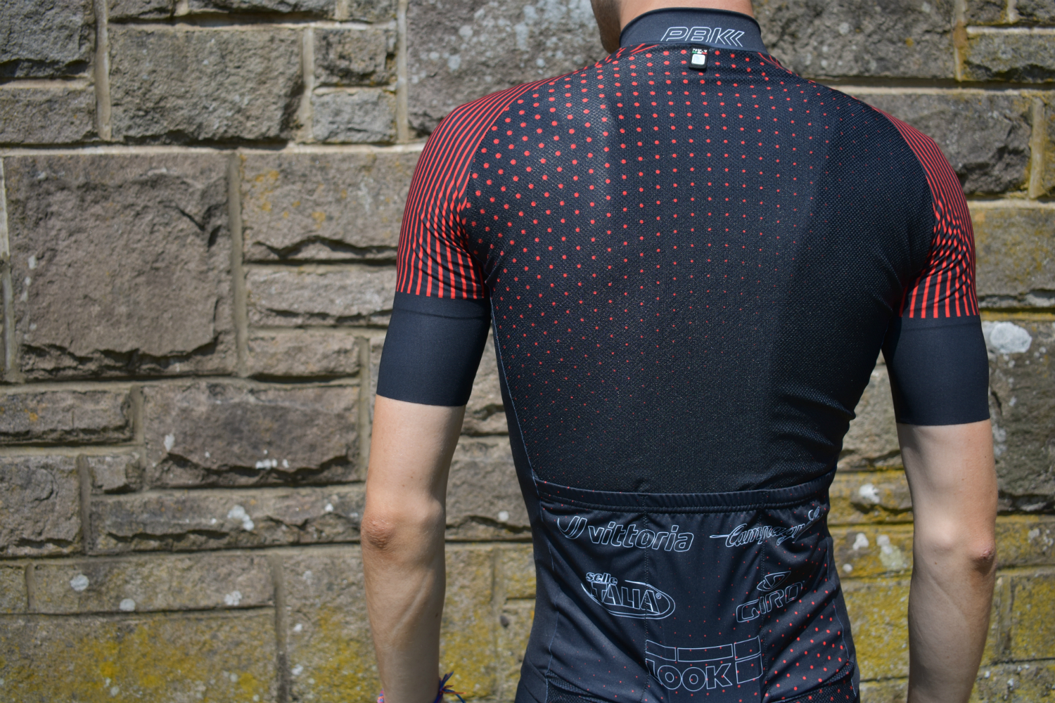 a close up of the back of the pbk santini jersey