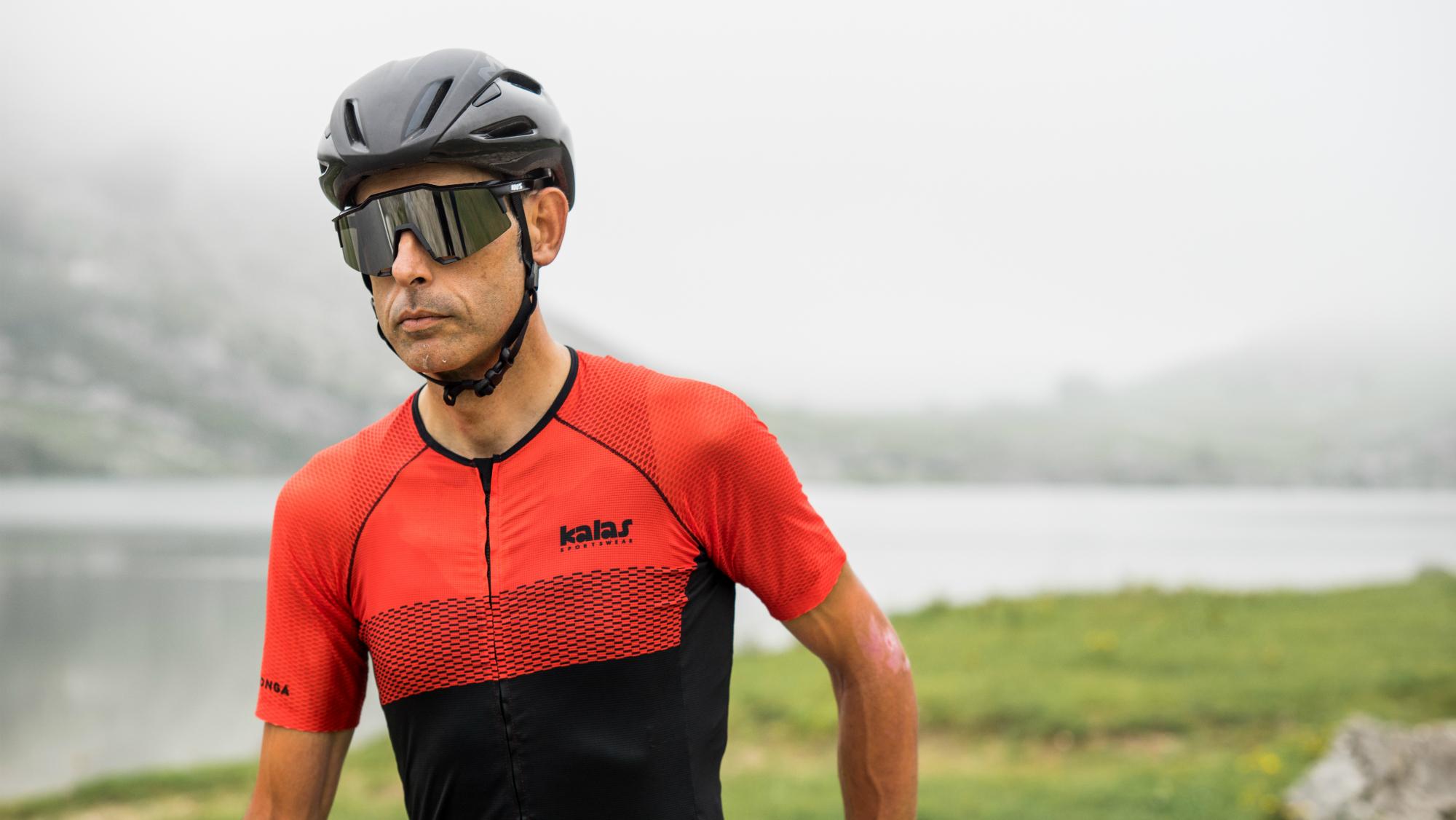 a cyclist stood wear the kalas covadonga jersey