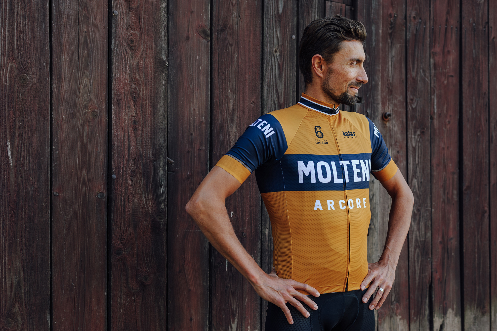 a cyclist stood wearing the molteni jersey