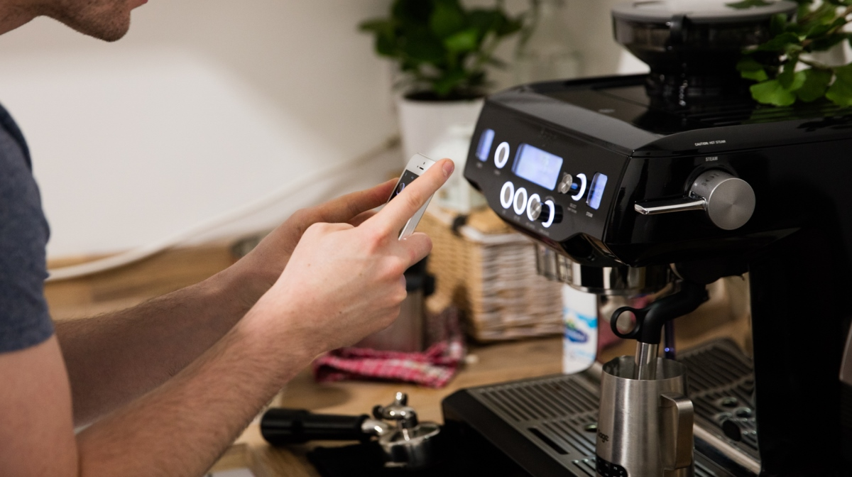 jm taking a picture of the smiley face symbol on the sage by heston blumenthal coffee maker