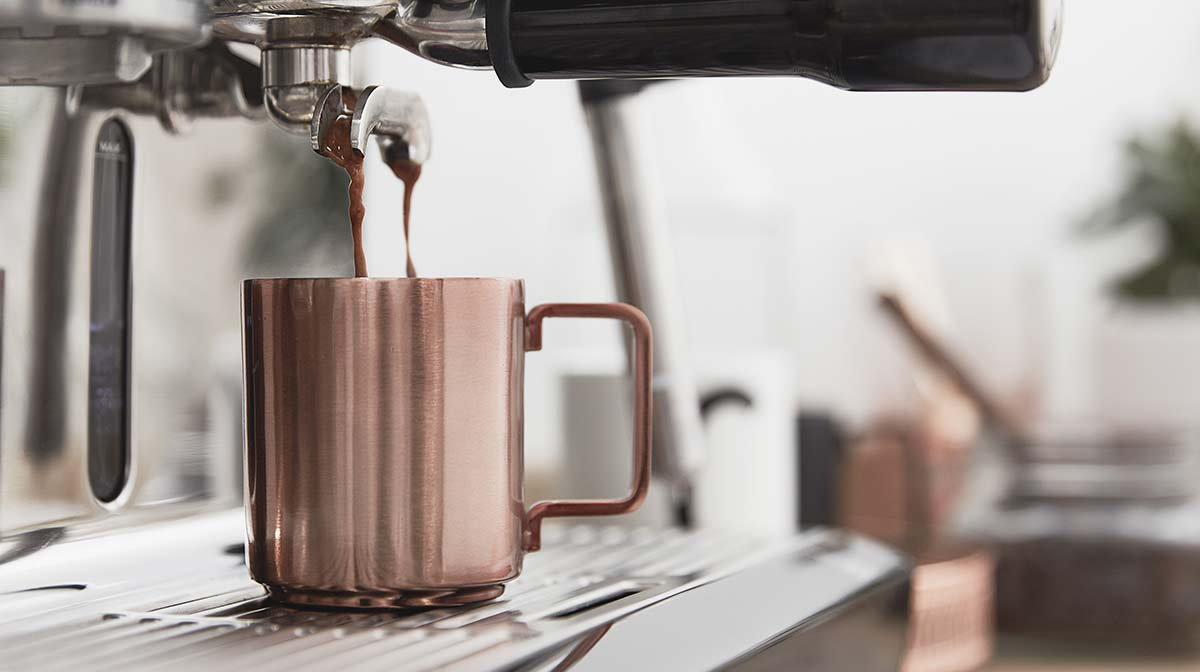 sage by heston blumenthal the oracle coffee machine in the iwoot kitchen with copper mug