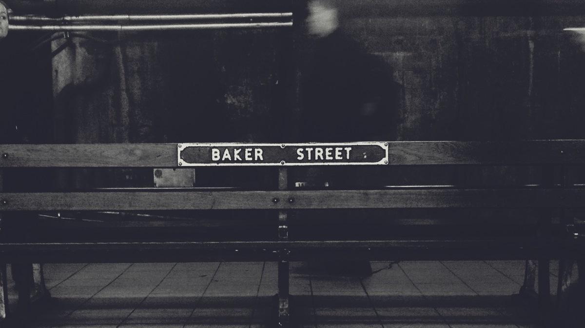 baker street sign on bench likely on tube station platform