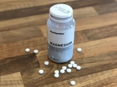 a bottle of magnesium tablets on a table