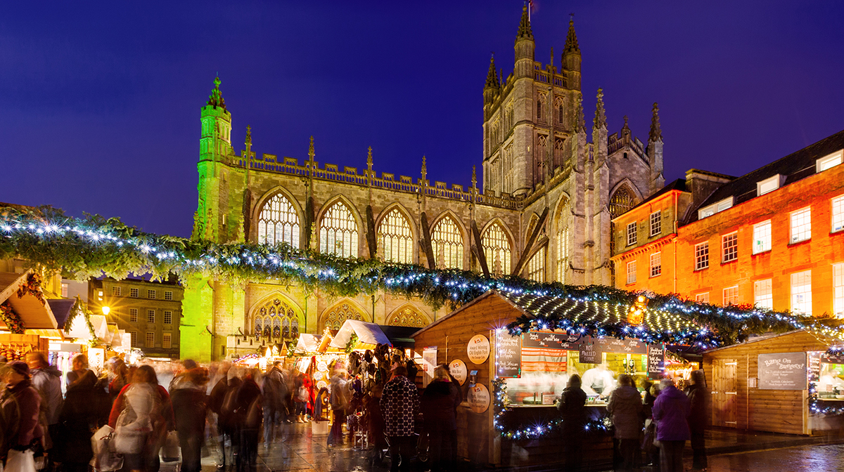 Bath Christmas Market at night in front of Cathedral