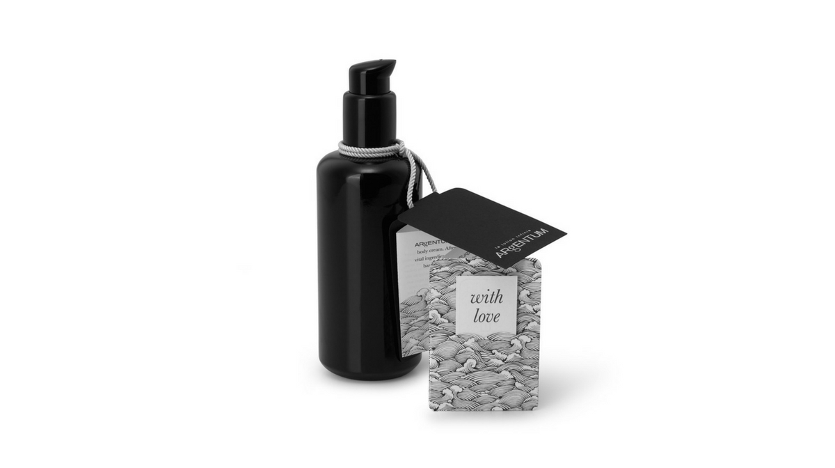 La Lotion Infinie Body Moisturiser by ARgENTUM with hangtag packaging.