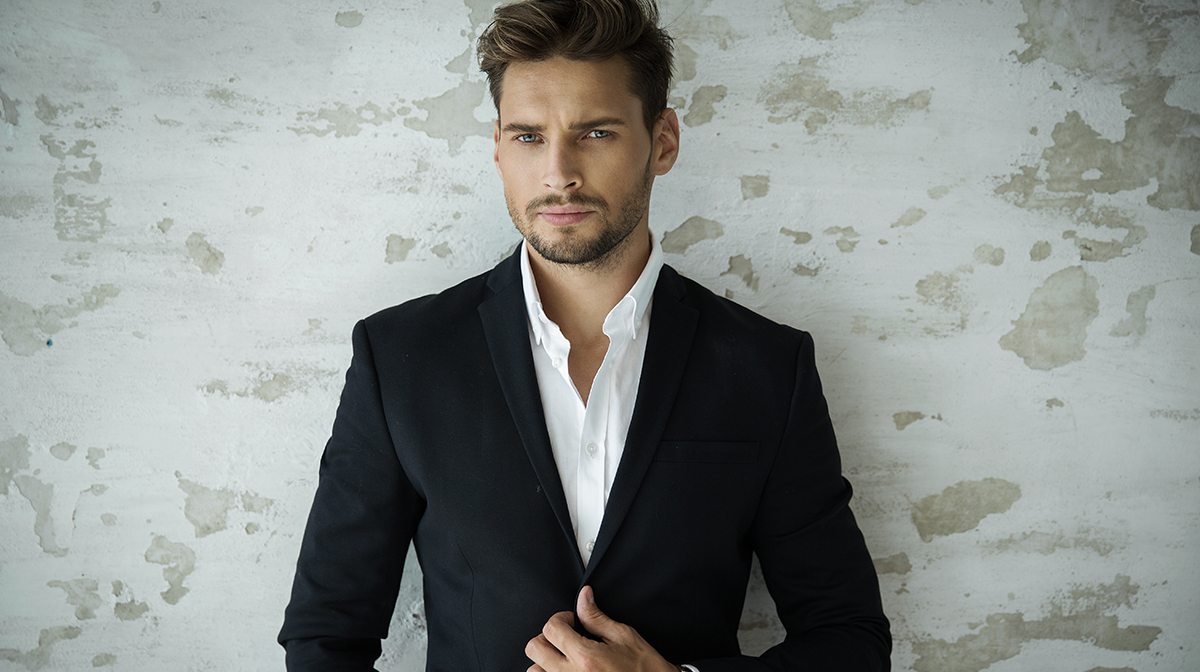 Handsome man in suit with unbuttoned shirt