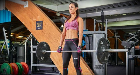 fitness woman holding a bar