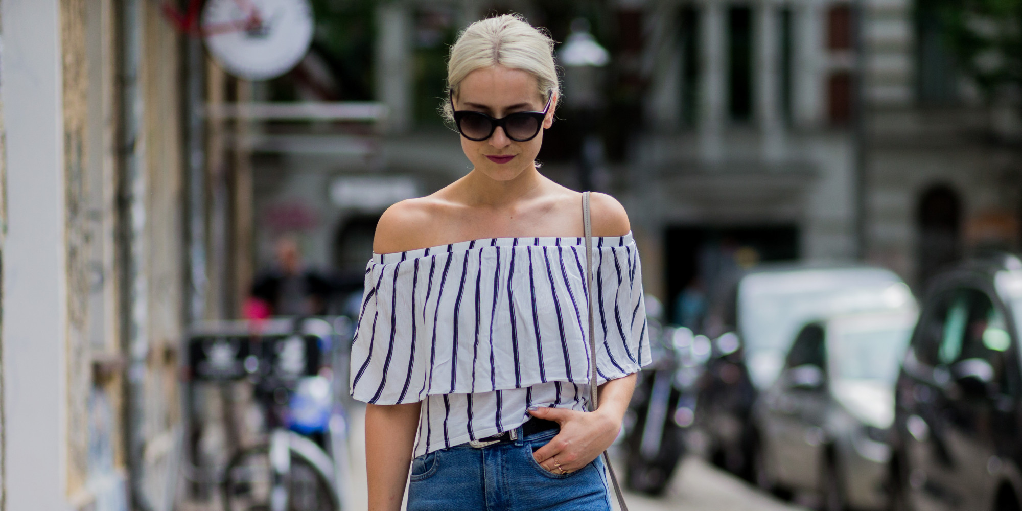 BERLIN, GERMANY - MAY 29: Miriam Mache wearing a white navy striped off shoulder shirt from Zara, a Radley London bag, blue BDG denim jeans, Rodenstock sunglasses on May 29, 2016 in Berlin, Germany. (Photo by Christian Vierig/Getty Images)